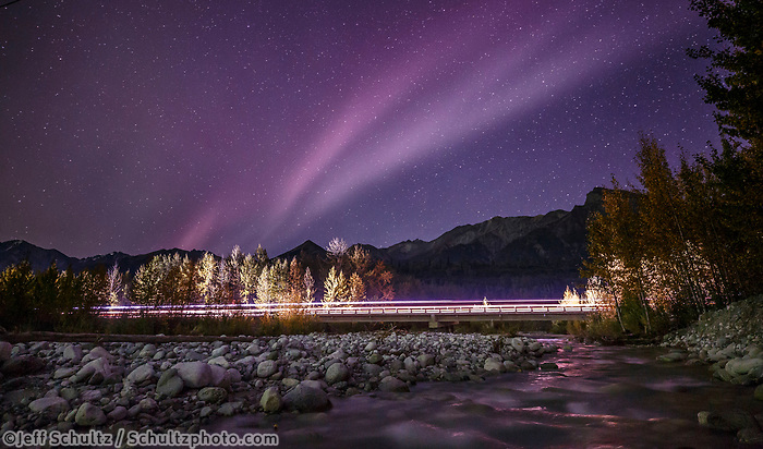 Fall landscape of Aurora (Northern Lights) over Glenn Highway lit up with vehicle lights at Granite Creek in Sutton, Alaska in Matanuska Valley... Southcentral, Alaska<br /> <br /> Photo by Jeff Schultz/SchultzPhoto.com  (C) 2018  ALL RIGHTS RESERVED
