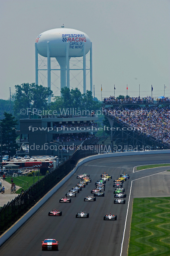The field lines up along the back straight for the start.
