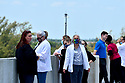 PEMBROKE PINES, FL - May 08: Doctors and nurses from Memorial Hospital West at the top of the parking garage to watch the U.S. NAVY Blue Angels fly over Broward County Memorial Hospital West and C.B. Smith Park test site for COVID-19 on May 08, 2020 in Pembroke Pines, Florida. The Blue Angels took to the sky to pay tribute to the COVID-19 front line responders and essential workers with formation flights.    ( Photo by Johnny Louis / jlnphotography.com )