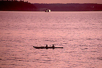 Sea kayaker at sunset, Puget Sound near Seattle, Washington