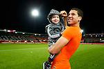 Nederland, Rotterdam, 15 oktober 2012.Interland.Jong Oranje-Jong Slowakije (2-0).Jeffrey Bruma van Jong Oranje viert feest met zijn nichtje na afloop van de wedstrijd