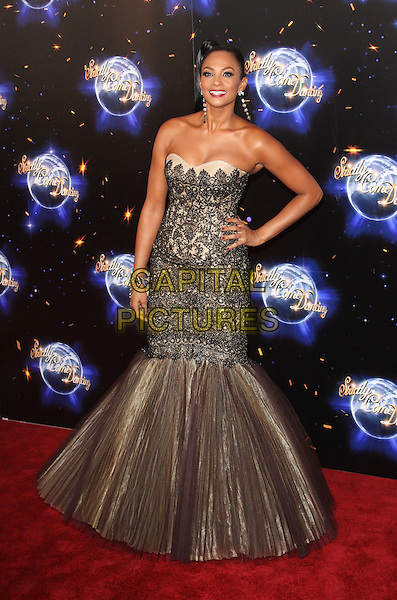 ALESHA DIXON  .'Strictly Come Dancing' Launch Event at BBC Studios, London, England..September 7th 2011.full length black beige gold lace strapless dress fishtail tulle pleats pleated hand on hip.CAP/ROS.©Steve Ross/Capital Pictures