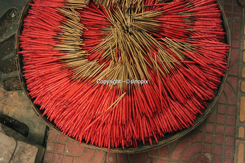 A basket of red incenses for well-wishers or visitors to worship the buddhas. It is a tradition to burn the incenses while visiting Chinese temples, and they were used especially in religious ceremonies. .12 Jul 2010