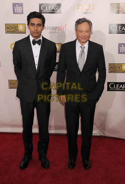 Suraj Sharma, Ang Lee.arriving at the 18th Annual Critics' Choice Movie Awards at the Barker Hanger in Santa Monica, California on January 10th 2013..full length tuxedo bow tie silver tie black jacket white shirt .CAP/ROT/TM.©Tony Michaels/Roth Stock/Capital Pictures