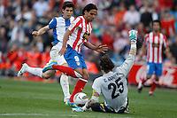 22.04.2012 MADRID, SPAIN - La Liga 11/12 match played between At. Madrid vs R.C.D. Espanyol (3-1) at Vicente Calderon stadium. the picture show Radamel Falcao Garcia (Colombian striker of At. Madrid) and Cristian Dario Alvarez (Goalkeeper of Espanyol)