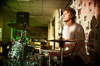 Sisters drummer David Goudy focuses on the beat and looks out into the audience at the SPU Covers Concert. The Sisters jam band consisted of 7 members for Friday's performance.