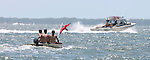 Memorial Day weekend celebrants head out the mouth of the Carrabelle River in all types of boats to attent the annual White Trash Bash at Dog Island off the coast of Carrabelle Sunday May 27, 2007.    (Mark Wallheiser/TallahasseeStock.com)