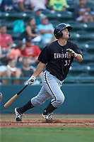 Justin Yurchak (33) of the Kannapolis Intimidators follows through on his swing against the Hickory Crawdads at L.P. Frans Stadium on July 20, 2018 in Hickory, North Carolina. The Crawdads defeated the Intimidators 4-1. (Brian Westerholt/Four Seam Images)