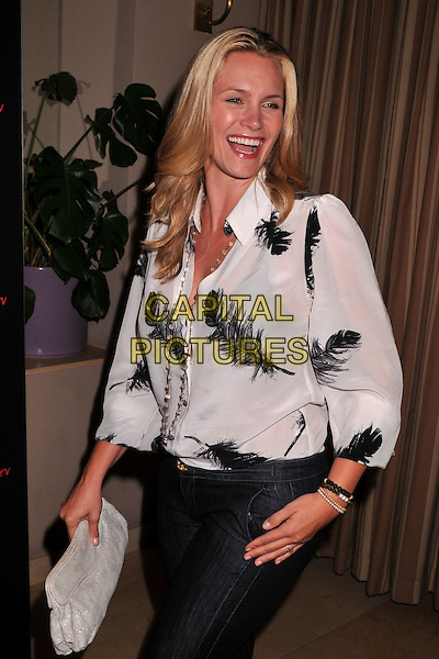 "NATASHA HENSTRIDGE.Teen.com's ""Haute & Bothered"" Online Series Launch Party held at the Sunset Tower Hotel, West Hollywood, CA, USA..May 4th, 2009.half length white black sheer blouse top clutch bag grey gray laughing feather print .CAP/ADM/BP.©Byron Purvis/AdMedia/Capital Pictures."