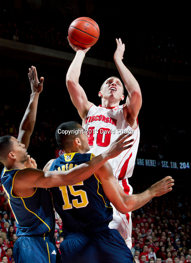 Wisconsin Badgers forward Jared Berggren (40) shoots the ball during a Big Ten Conference NCAA college basketball game against the Michigan Wolverines Saturday, February 9, 2013, in Madison, Wis. The Badgers won 65-62 (OT) (Photo by David Stluka)