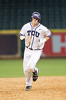 Kevin Cron #00 of the Texas Christian Horned Frogs rounds the bases after hitting a 3-run home run in the top of the ninth inning against the Sam Houston State Bearkats at Minute Maid Park on February 28, 2014 in Houston, Texas.  The Bearkats defeated the Horned Frogs 9-4.  (Brian Westerholt/Four Seam Images)
