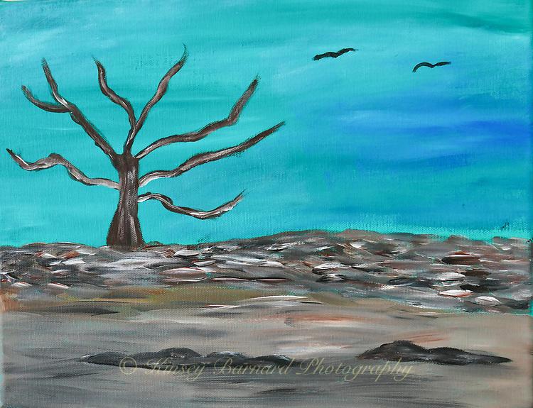Lone dead tree standing in a field of desolation. Two buzzards soar above in an eerie sky.