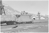 RGS caboose #0409 at Durango with a &quot;bad order&quot; tag attached.  Parts of drop-bottom gondolas #826 and #787 can be seen at left.<br /> RGS  Durango, CO  ca. 8/1940