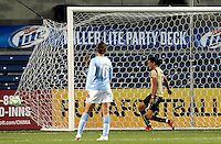 FC Gold Pride forward Christine Sinclair (12) scores the game's only goal as Chicago Red Star midfielder Carli Lloyd looks on.  The defeated the FC Gold Pride defeated the Chicago Red Stars 1-0 at Toyota Park in Bridgeview, IL on May 16, 2009.