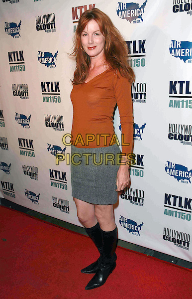 """BIRD YORK .West Coast Pre-Inaugural Party and live launch of """"Hollywood CLOUT!"""" held at Falcon Restaurant, Hollywood, California, USA, 13 January 2009..full length orange sweater jumper .grey gray skirt black knee high boots .CAP/ADM/TC.©T. Conrad//Admedia/Capital Pictures"""