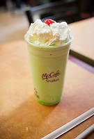 A Shamrock Shake proudly waits to be devoured in a  McDonald's restaurant New York on Wednesday, February 15, 2012. For the first time in the history of the chain the minty concoction will be available in all stores nationwide up until March 17, St. Patrick's Day. The shake has a cult-like following and was first introduced in 1970. Previously local franchisees were permitted to either carry or not carry the product.  (© Richard B. Levine)