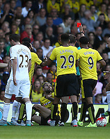 Valon Behrami of Watford is shown a red card by   during the Barclays Premier League match Watford and Swansea   played at Vicarage Road Stadium , Watford