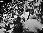 (Amherst, MA, 01/29/1993) Some 4,000 basketball fans rush the floor of the Curry Hicks Cage at UMass Amherst at the conclusion of the Final Rage in the Cage on January 29, 1993. The venue which in still in use was replaced by the more modern and much larger Mullins Center. Photo by Christopher Evans