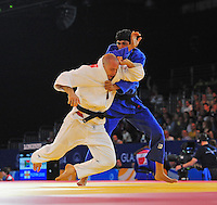 Scotland's Matthew Pursey (wearing white) during his victory in the men's -90kg preliminary round of 16 contest against India's Avtar Singh<br /> <br /> Photographer Chris Vaughan/CameraSport<br /> <br /> 20th Commonwealth Games - Day 3 - Saturday 26th July 2014 - Judo - SECC - Glasgow - UK<br /> <br /> © CameraSport - 43 Linden Ave. Countesthorpe. Leicester. England. LE8 5PG - Tel: +44 (0) 116 277 4147 - admin@camerasport.com - www.camerasport.com