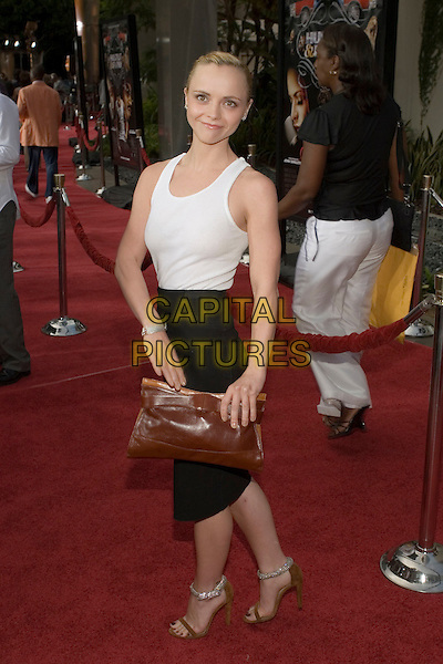 "CHRISTINA RICCI.At the ""Hustle & Flow"" Los Angeles Film Premiere,.held at the Arclight Cinerama Dome, .Hollywood, California, USA, 20th July 2005..full length white vest tank top black skirt skinny thin tattoo tucked in diamante ankle strap shoes orange brown clutch bag.Ref: ADM.www.capitalpictures.com.sales@capitalpictures.com.©Zach Lipp/AdMedia/Capital Pictures."