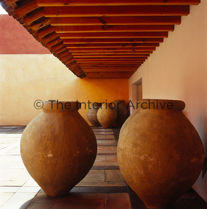 The large terracotta pots to one side of the main courtyard are from the Yucatan peninsula and would have been used to transport olive oil
