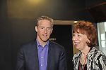 Erik Lindbergh, grandson of aviator Charles Lindbergh, participates in 85th anniversary celebration of his grandfather's historic solo flight across Atlantic, on Saturday May 19, 2012, at Cradle of Aviation museum, Long Island, New York. Lindbergh (left) here with museum's Director of Development, Carol Nelson (right) before he participated in panel that discussed the 1927 flight of C. Lindbergh's Spirit of St. Louis - along with future of aviation, 10th anniversary of Cradle of Aviation opening and 35th anniversary of Charles A. & Anne Morrow Lindbergh Foundation were also celebrated.