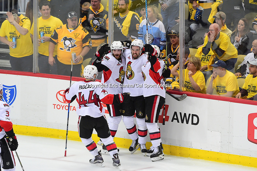 May 25, 2017: Ottawa Senators center Jean-Gabriel Pageau (44), right wing Bobby Ryan (9), defenseman Ben Harpur (67) and defenseman Erik Karlsson (65) celebrate a goal during game seven of the National Hockey League Eastern Conference Finals between the Ottawa Senators and the Pittsburgh Penguins, held at PPG Paints Arena, in Pittsburgh, PA. The Pittsburgh Penguins defeat the Ottawa Senators 3-2 in double overtime to win the NHL Eastern Conference Championship and advance to face the Nashville Predators in the Stanley Cup Finals.  Eric Canha/CSM