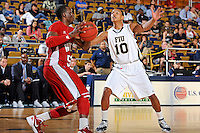 28 January 2012:  FIU guard Cameron Bell (10) defends WKU guard T.J. Price (52) during a full-court press in the second half as the Western Kentucky University Hilltoppers defeated the FIU Golden Panthers, 61-51, at the U.S. Century Bank Arena in Miami, Florida.