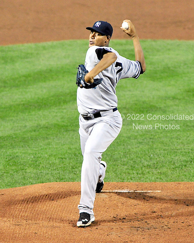 New York Yankees pitcher Ivan Nova (47) works in the first inning against the Baltimore Orioles at Oriole Park at Camden Yards in Baltimore, Maryland in the second game of a doubleheader on Sunday, August 28, 2011.  .Credit: Ron Sachs / CNP.(RESTRICTION: NO New York or New Jersey Newspapers or newspapers within a 75 mile radius of New York City)