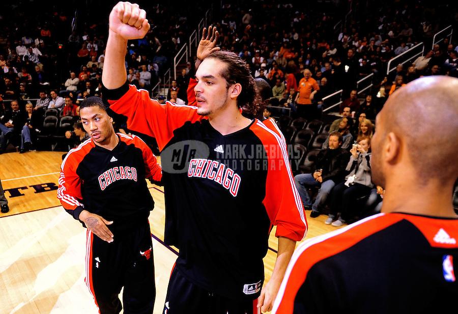 Jan. 22, 2010; Phoenix, AZ, USA; Chicago Bulls center (13) Joakim Noah greets teammates prior to the game against the Phoenix Suns at the US Airways Center. Mandatory Credit: Mark J. Rebilas-