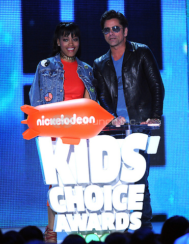 LOS ANGELES, CA - MARCH 12: Keke Palmer and John Stamos onstage at the Nickelodeon 2016 Kids Choice Awards at The Forum on March 12, 2016 in Inglewood, California. Credit: PGFM/MediaPunch
