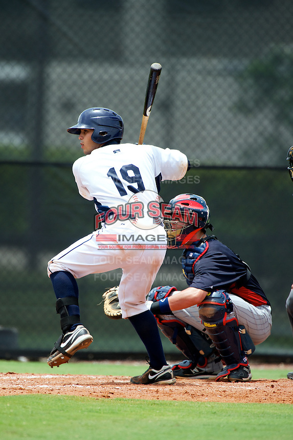 GCL Rays Armando Araiza #19 bats in front of catcher Kelly Cross during a Gulf Coast League game against the GCL Twins at the Charlotte Sports Complex on July 19, 2012 in Port Charlotte, Florida.  GCL Twins defeated the GCL Astros 4-2.  (Mike Janes/Four Seam Images)
