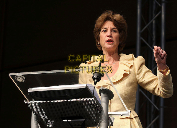 KATHLEEN KENNEDY TOWNSEND Speaks at the Economic Business Education Meeting for Women, Milan, Italy, 30th March 2009..half length yellow suit jacket hand speaking podium stand .CAP/ADM/LIV.©Francesco Bonfanti/Liverani/Admedia/Capital PIctures