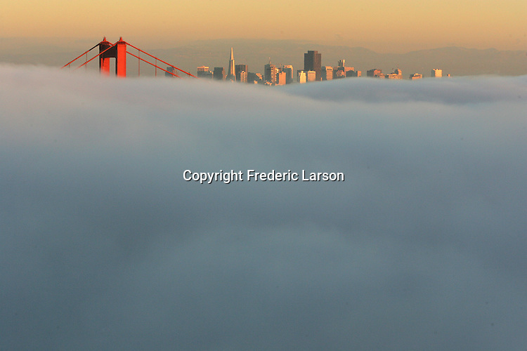 The evening fog blankets the bay leaving Coit tower the City skyline visible through the north tower..11/13/07.{Photographed by Frederic Larson}