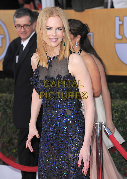 Nicole Kidman Urban (wearing Vivienne Westwood).Arrivals at the 19th Annual Screen Actors Guild Awards at the Shrine Auditorium in Los Angeles, California, USA..27th January 2013.SAG SAGs half length black blue lace dress sheer sleeveless .CAP/DVS.©DVS/Capital Pictures.