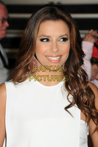 """EVA LONGORIA .at Walt Disney Pictures' Premiere of """"Pirates of the Caribbean : On Stranger Tides"""" held at Disneyland in Anaheim, California, USA, May 7th 2011..4 four portrait headshot pink dangly earrings beauty  sleeveless white smiling  .CAP/ADM/BP.©Byron Purvis/AdMedia/Capital Pictures."""
