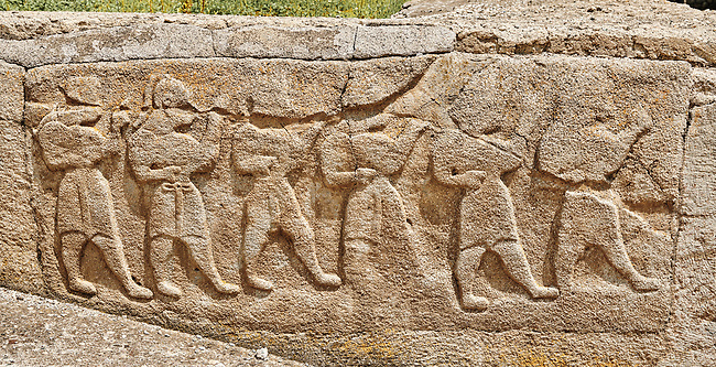 Pictures & Images Hittite relief sculpted orthostat panels of the Sphinx Gate. Panel depicts a procession. Alaca Hoyuk (Alacahoyuk) Hittite archaeological site  Alaca, Çorum Province, Turkey, Also known as Alacahüyük, Aladja-Hoyuk, Euyuk, or Evuk