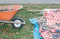 Flags are gathered together for disposal in a flag retirement ceremony in Belmont, Massachusetts, USA, on Sat. Oct. 14, 2017. Flag retirement ceremonies are intended to give a dignified end to flags no longer fit to serve as a symbol for the United States of America. The ceremony was organized by Eagle Scout candidate Robert Mountain, 17, of Belmont Boy Scout Troop 66 as his Eagle Scout project. Many of the flags in this image are from local cemeteries that did not have a proper way to dispose of the flags. This is the first such ceremony in Belmont.  The ceremony was held in park area surrounding Clay Pit Pond near Belmont High School.