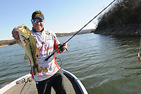 NWA Democrat-Gazette/FLIP PUTTHOFF <br /> Bohannan shows one of three largemouth bass he caught Jan. 27 2017 from one point on the upstream end of Table Rock Lake.