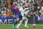 Luis Suarez of FC Barcelona holds off pressure from  Daniel Carvajal of Real Madrid during the match of La Liga between Real Madrid and Futbol Club Barcelona at Santiago Bernabeu Stadium  in Madrid, Spain. April 23, 2017. (ALTERPHOTOS)