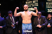 Nathan Gorman on the scales during a Weigh In at the BT Studios, Queen Elizabeth Olympic Park on 12th July 2019
