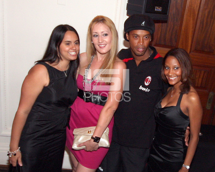 Ronaldinho of AC Milan poses with a few admirers at a reception for AC Milan at DAR Constitution Hall in Washington DC on May 24 2010.