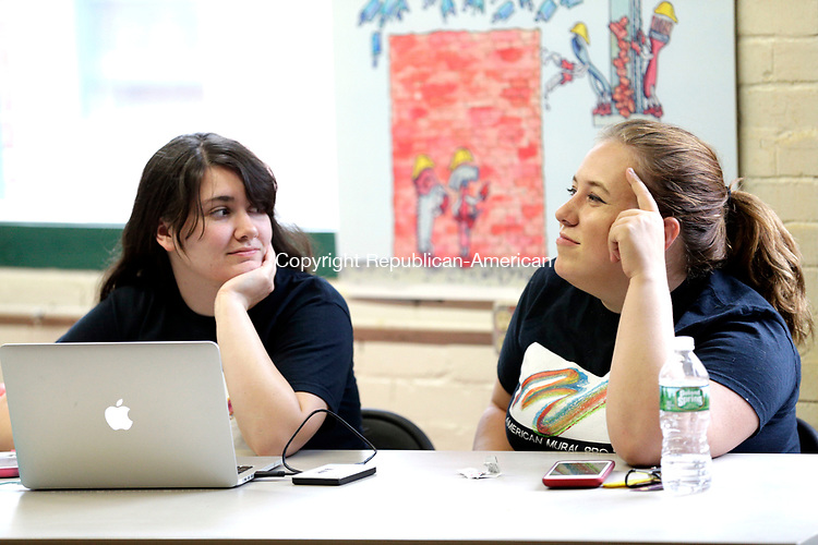 Winsted, CT- 07 August 2017-080717CM02-  Natalie Allyn of East Canaan, left, and Heather Damiani of Litchfield chat at Whiting Mills Studio in Winsted on Monday.  Apprentices who worked with the mural project celebrated the completion of its pilot Digital Storytelling Internship program by talking about the experience and showing off videos they created.      Christopher Massa Republican-American