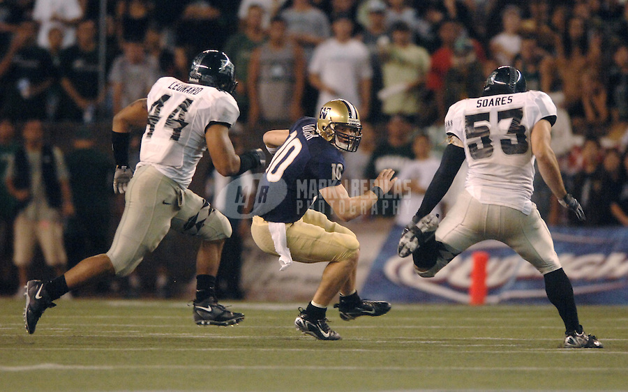 Dec 1, 2007; Honolulu, HI, USA;  Washington Huskies quarterback Jake Locker (10) is pursued by Hawaii Warriors linebacker Adam Leonard (44) and linebacker Blaze Soares (53) in the third quarter at Aloha Stadium. Mandatory Credit: Mark J. Rebilas-US PRESSWIRE