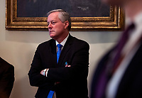 Acting Chief of Staff Mark Meadows listens as United States President Donald J. Trump holds a meeting with nurses on the COVID-19 response at the White House in Washington, DC, March 18, 2020, in Washington, D.C. <br /> Credit: Kevin Dietsch / Pool via CNP/AdMedia
