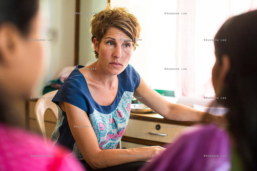 Tamsin Greig, an actress from the United Kingdom, speaks with Chinta (name changed), aged 18, about her past experiences as they sit in Nirmal Bhavan, a rehabilitation home for trafficked and rescued girls run by Tearfund partner NGO Oasis India, in Mumbai, Maharashtra, India on 20 February 2014. Given away by her parents who were in a large amount of debt, Chinta was given to a woman who forced her to work in her house, and then forced her in to prostitution. Often she saw 10 customers a day, but if there was no work she was hung from a ceiling fan and beaten. Photo by Suzanne Lee/Tearfund