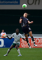 Abby Wambach (20) of the Washington Freedom goes up for a header in front of Tina Ellertson (8) of the Saint Louis Athletica at RFK Stadium in Washington, DC.  The Washington Freedom defeated Saint Louis Athletica, 3-1.