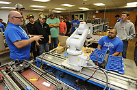 NWA Democrat-Gazette/ANDY SHUPE<br /> Billy Graham (left), an instructor at Northwest Technical Institute in Springdale, speaks Wednesday, May 32, 2017, to students from Huntsville High School about the school's robotics and electronics program as NTI student Hector Torres (right) operates a robot at the facility in Springdale. Schools from Huntsville, Har-Ber and Elkins came to the school to tour the facility and meet with representatives from Be Pro, Be Proud, a group that promotes technical education options to high school students.