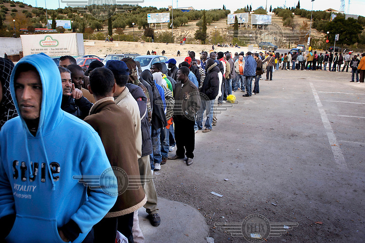 A queue of unemployed immigrants at an aid centre in Jaen. Many of migrants come to the region to pick olives but this year there is competition for the work. The economic collapse means that work once shunned by the indigenous population is now sought after by unemployed Spaniards.