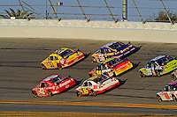 Clint Bowyer (#33),Juan Pablo Montoya (#42), Martin Truex,Jr. (#56),Jeff Gordon (#24), Greg Biffle (#16) and Carl Edwards (#99), two and three wide acton.